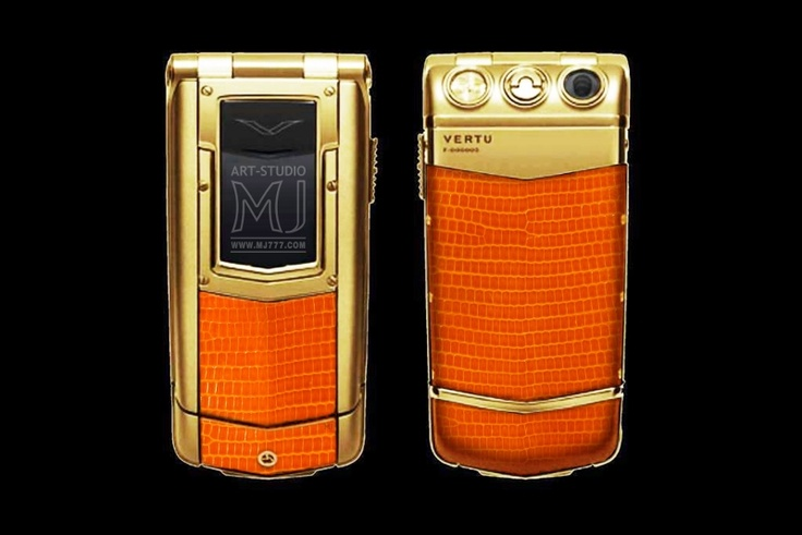 Vertu Ayxta Exotic - MJ Edition - Iguana Lizard Leather - Gold Phone. Vertu Ayxta can be covered with gold and other precious metals. The decoration by skin of iguana and other types of exotic skin is possible. Also personalisation by incrustation of the coat of arms, zodiac sign and other symbolics from precious metals and stones is possible.        http://exclusive-mj.com/en/