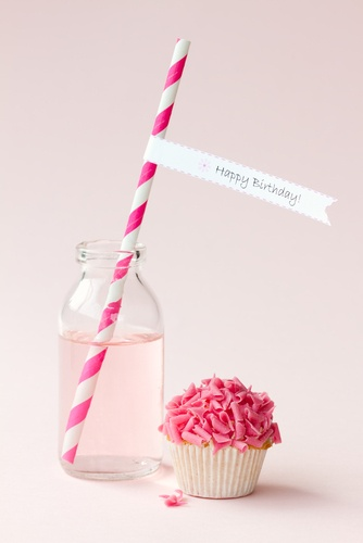 Pink Birthday Paper Straws and a pink cupcake