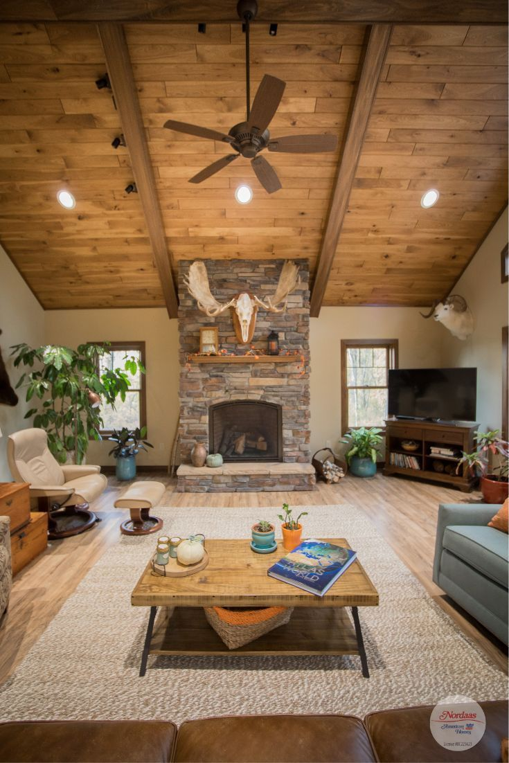 Get Cozy In This Rustic Living Room With Wood Vaulted Ceiling And Stone Fireplace Far Vaulted Ceiling Living Room Farm House Living Room Vaulted Living Rooms