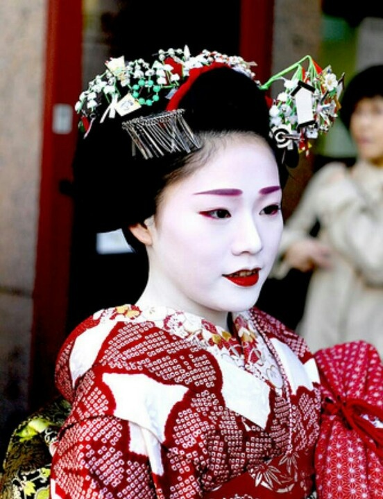 Maiko; Maiko originated from women who served green tea and dango (Japanese dumpling made from rice flour) to people who visited the Kitano Tenman-gū or Yasaka Shrine (these are the two of the famous shrines in Kyoto) at teahouses in the temple town about 300 years ago. At first, women served only green tea and dango, but they gradually started to perform songs and dances for visitors. http://en.wikipedia.org/wiki/Maiko