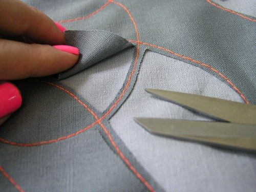 Now for the fun part! It's time to cut away some of the fabric. Using sharp scissors, pick a section to cut away, and carefully snip the fabric close to the seams.