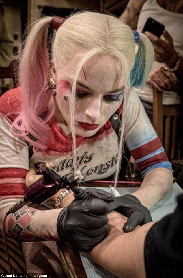 New trade? Margot Robbie etching an inked design onto Suicide Squad director David Ayer's ...