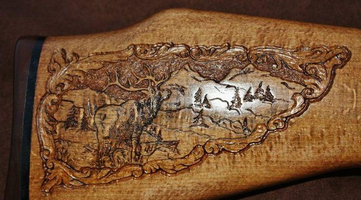 Custom carved gun stock with elk gunstock carving by