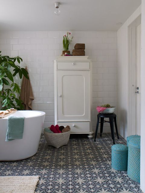 warm white bathroom #tiles #greenery #cabinet