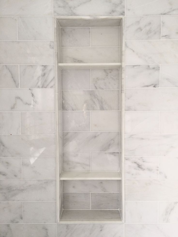 Carrara marble shower niche - clean look                                                                                                                                                      More