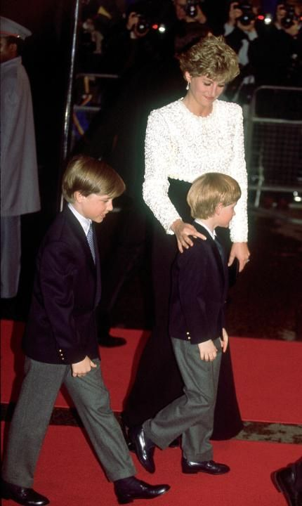 7 April 1992 The Princess of Wales and her children, Princes William and Harry arriving for the premiere of 'Hook'. Princess Diana wears a gown by Catherine Walker. (Photo by Jayne Fincher/Getty Images). Source cc