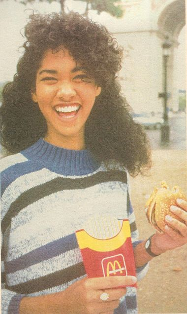 Young Kimora Lee Simmons looking unpretentious and cool, with a big mac