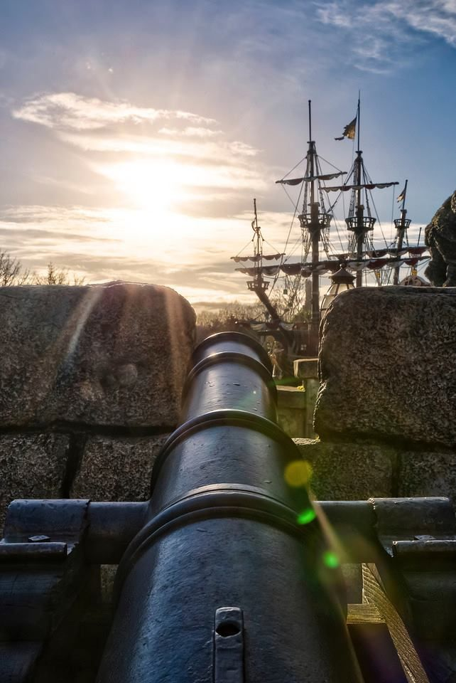 A cannon's view from the fort with a pirate ship near!  Pirates!