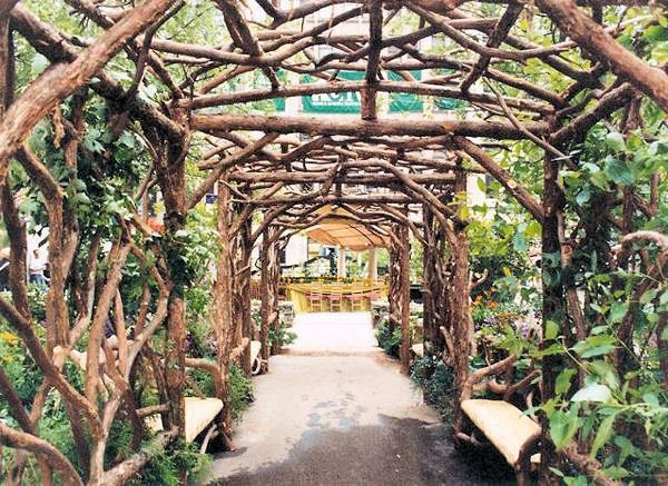 Twig trellis twig pergola from romancing the woods inc for Timber garden arch designs