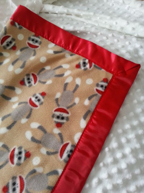 Adorable sock monkey baby blanket with red satin on the outside. Made with fleece so it is very soft and cuddly. on Etsy, $14.00