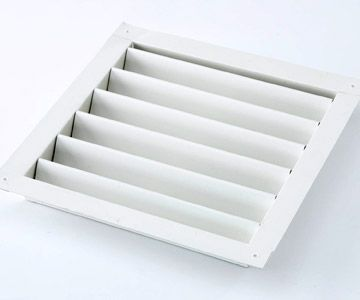 Large wall louver (used for ventilation) placed in a drawer for wooden rubber stamp storage: