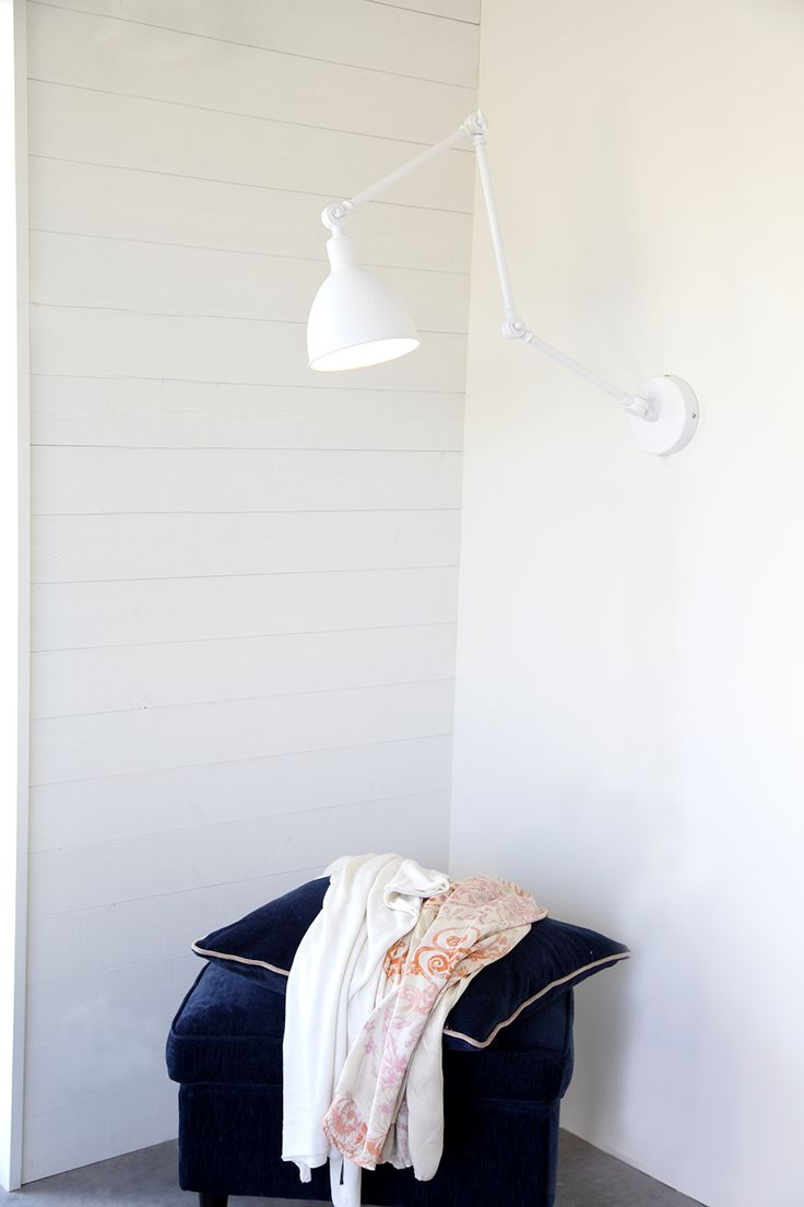 Wall lamp Bazar in White. You can find it also in black.