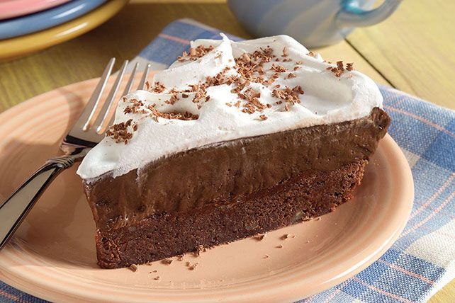 """A fudgy baked brownie """"crust"""" is topped with creamy chocolate pudding and whipped topping for a decadent, chocolate lovers' pie."""