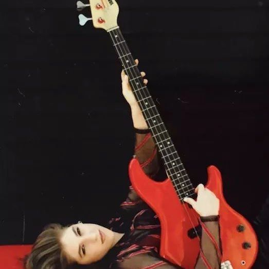 I play bass guitar. Here's a #tbt of me at around 17 in a fancy photo shoot with a fiery red bass. (My Washburn acoustic electric I own is black, for the record).
