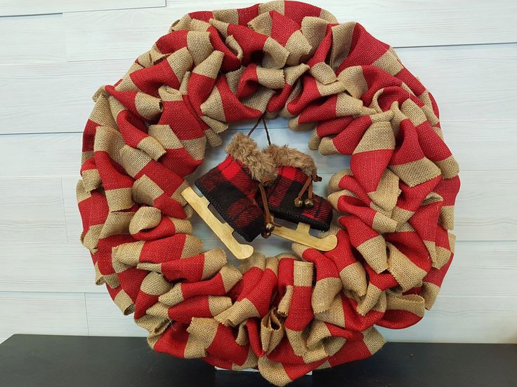 Large Holiday Wreath with Skates. . . #goldenforrest #goldenforrestcreations #burlapwreath #burlap #red #wreath #wreathidea #skates #plaid #holidaydecor #seasonaldecor #christmasdecor #doordecor