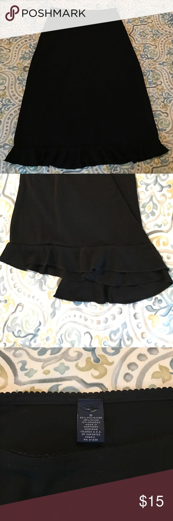 "Black Ruffle Skirt/Slip/Underskirt Black GAP slit/underskirt. A little too sheer to wear as a standalone skirt but can be paired with opaque black tights to wear without over Skirt! Use under a skirt to give a fun and flirt flare! Ruffles at bottom. Stretchy waistband 12.5"" across, 16"" across at hip, 22"" long from top of waist to top of ruffle, then ruffle adds another 2"" of length. Purchased at an outlet store which is why brand is cut out. No flaws. Feel free to ask any questions any make…"
