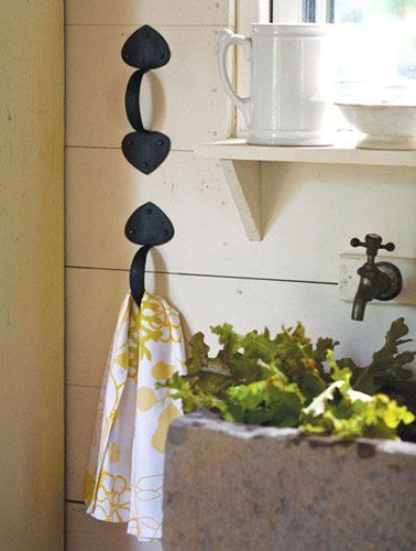 Hang kitchen towels from antique handles