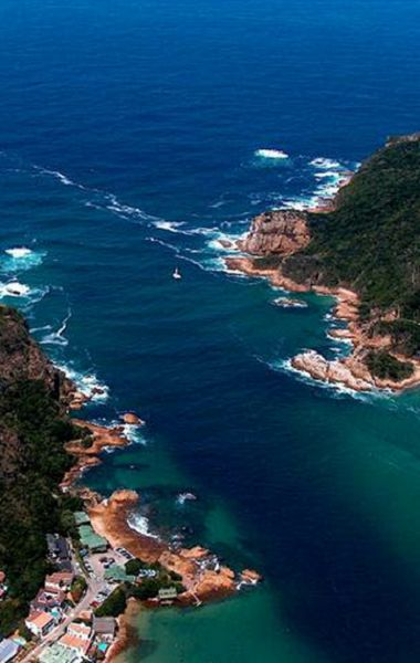 Knysna Heads, South Africa! Talk about a home to get a view like this! I still remember how winded I was when we climbed up for the best view possible! Totally worth it!!
