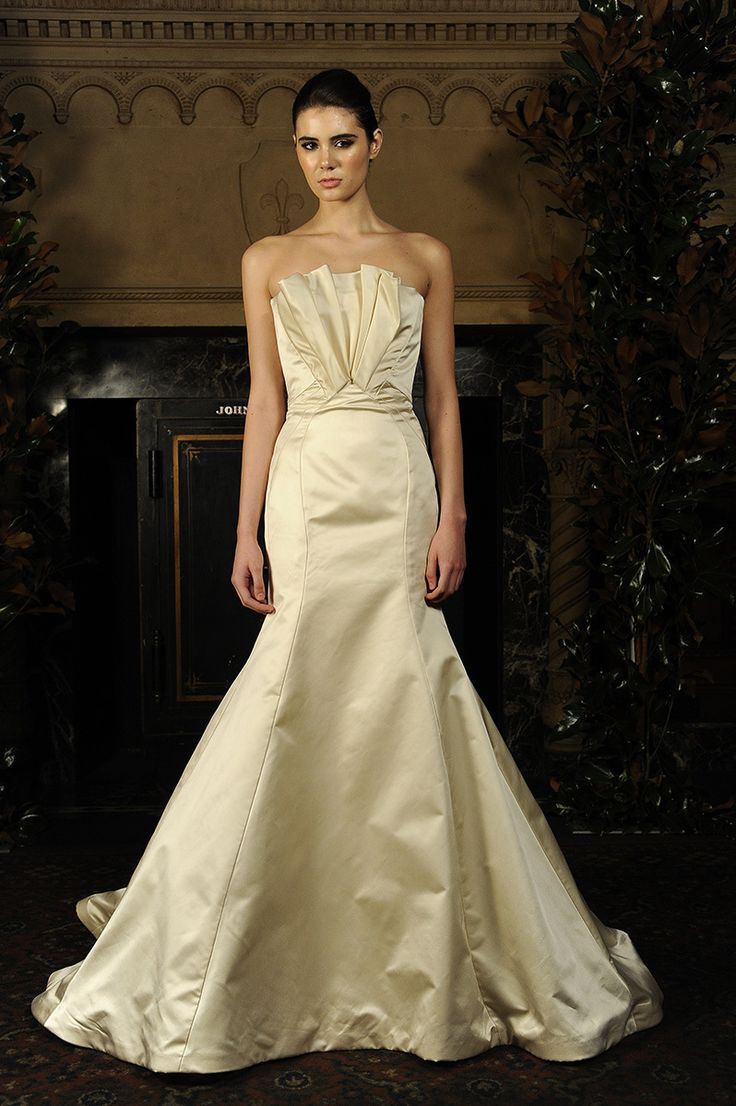 The pleated fan on the neckline gives this Austin Scarlett wedding gown a glamorous edge {photo: Dan Lecca}