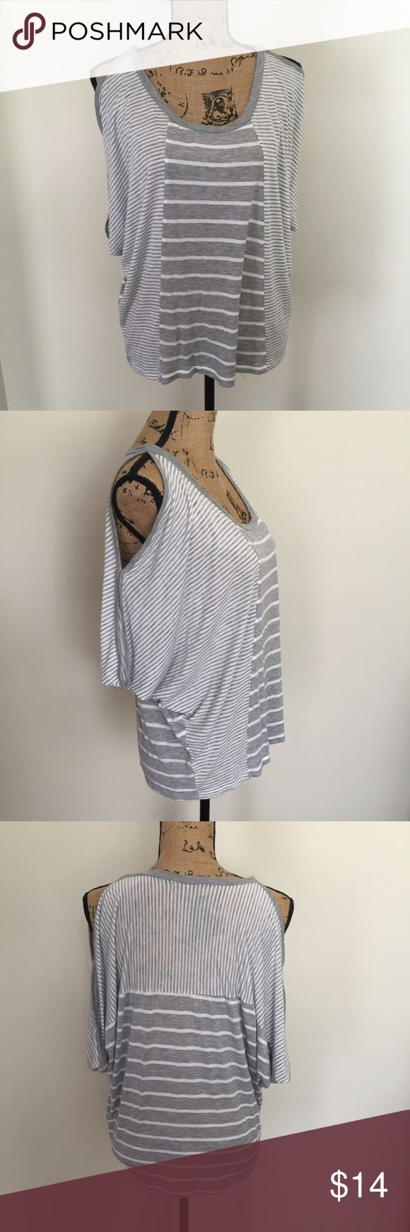 Just Ginger Striped Cold Shoulder Dolman top Gray and white striped cold shoulder dolman sleeve tunic top by Just Ginger from Nordstrom. Excellent preowned condition, only being worn once for a few hours. Marled a size large but I am a small and wore it oversized (as pictured on my size 6 mannequin) and it looks super cute. 💗 No hold or trades for any reason. I ship within 1 business day, which does not include weekends or holidays. Poshmark only. Thank you for looking! 💗 Nordstrom Tops…