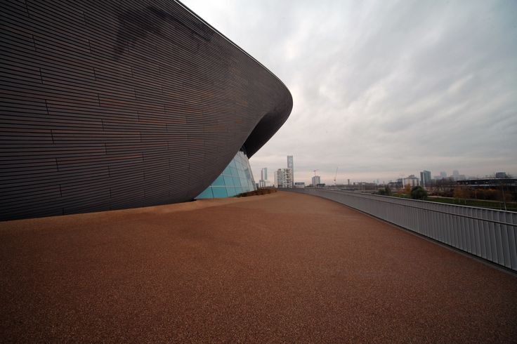 https://flic.kr/p/q7tBf3 | The London Aquatics Centre (London Olympics 2012) | The London Aquatics Centre is an indoor facility with two 50-metre (160-foot) swimming pools and a 25-metre (82-foot) diving pool in Queen Elizabeth Olympic Park at Stratford, London, it was one of the main venues of the 2012 Summer Olympics and the 2012 Summer Paralympics. The centre was used for the swimming, diving and synchronised swimming events. After significant modification the centre opened to the public…
