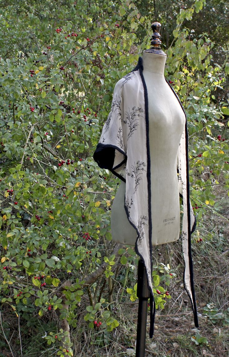Embroidered silk and merino wool.