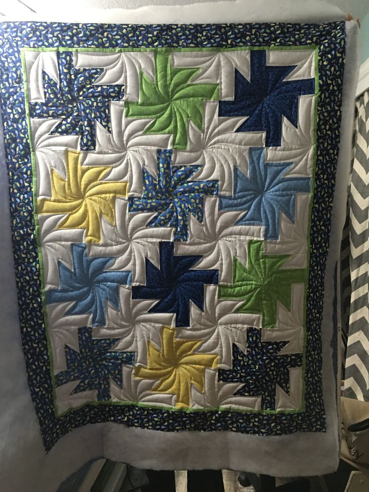 Kimberly and her APQS machine Lucey – which she affectionately calls Nessie – created this gorgeous charity quilt for a group called Quilts Beyond Borders.  Great free motion work!