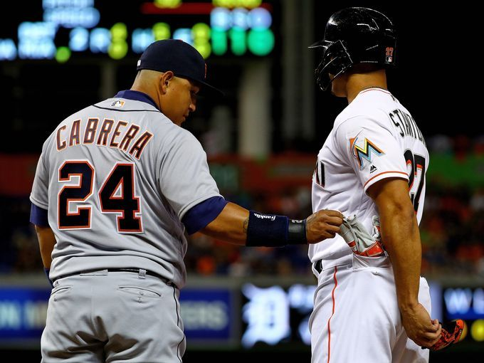 Game 1 - Apr 5 - Detroit 4-0 Miami. B2. Miguel Cabrera steals a batting glove from the pocket of Giancarlo Stanton.  [Mike Ehrmann, Getty Images]
