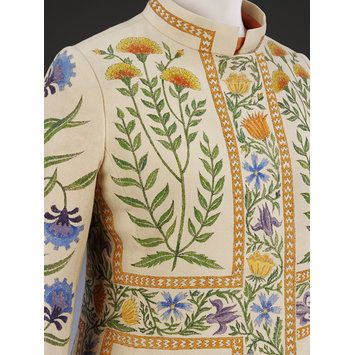 Striking 1970 hand-painted wool crepe coat with vibrant floral motifs by Bellville Sassoon and motif design by Richard Cawley which was inspired by Indian art in the VA's Collection...