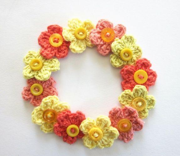 1 Sett m/12 hekla blomster i orange, lakserosa og gult.