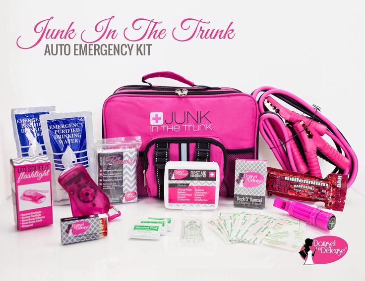 Junk in the Trunk Auto Emergency Kit from Damsel in Defense. Includes first aid kit, pink jumper cables, emergency water pouches, a flashlight and more! Everything you need to stay prepared.