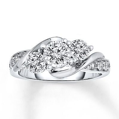 Give her a three stone engagement ring that symbolizes your future love together.