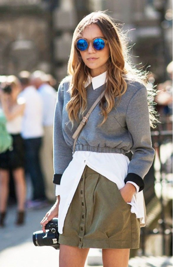 We're all about pairing mirrored sunglasses with a mini skirt