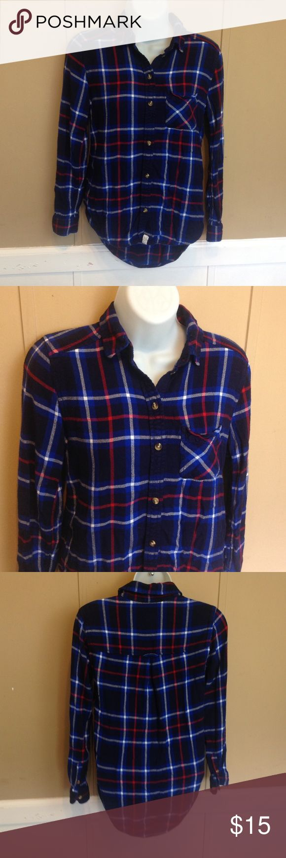 """American Eagle Blue Plaid Boyfriend Fit Flannel Maker: American Eagle ♥ Material: Viscose ♥ Color: Navy Blue Plaid ♥ Measured Size: Pit to pit- 17"""" Pit to cuff-16"""" Shoulder to waist- 23"""" in front, back is longer  ♥ Tag Size: XS ♥ Actual Size: XS PLEASE CHECK YOUR ACTUAL MEASUREMENTS TO MAKE SURE IT IS THE RIGHT SIZE! THANKS! ♥ Condition: Great ♥ Item #: (office use only) E  Follow us on Instagram and facebook for coupon codes!  INSTAGRAM-thehausofvintage1984 Facebook- intergalactic haus of…"""