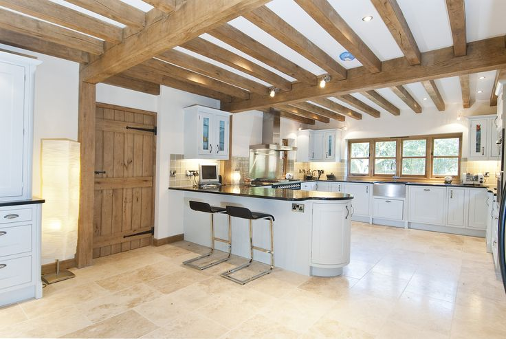 #oak framing brings character and an contemporary interior feel to this house