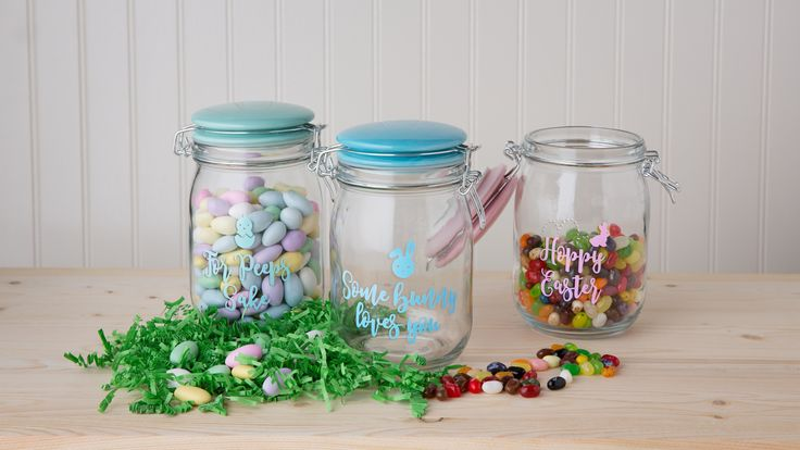 "Easter Canisters by Amici Home.  These Easter canisters are a great way to hold your peeps, chocolate eggs, or jelly beans!  Each glass canister comes with a matching ceramic lid that is hermetically sealed.  They read ""For Peeps Sake"", ""Some Bunny Loves You"", and ""Hoppy Easter""."