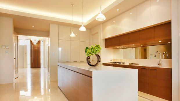 This gorgeous kitchen is bathed in light from the cornice lighting and the stylish pendant lights... (From our Grand display home at Blackwood Park, Craigburn Farm)