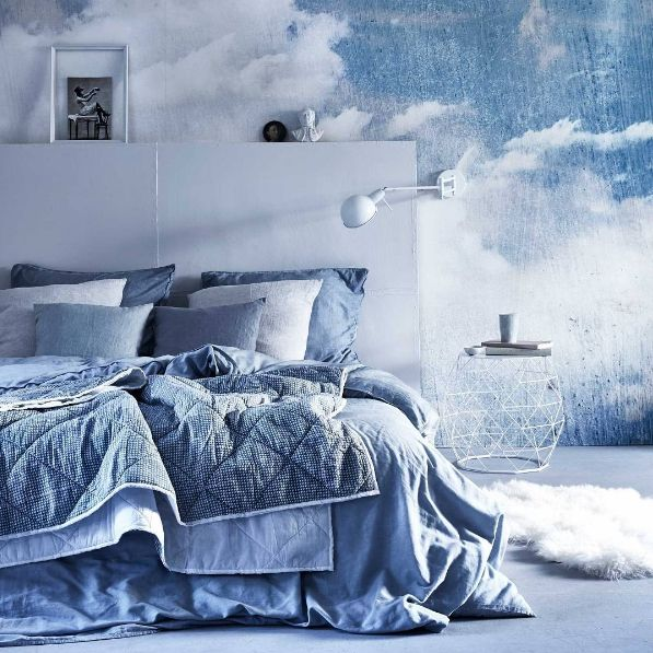 Cloud Puff wall mural featured on Vtwonen styled by Cleo Scheulderman. Wall mural | wallpaper | clouds | sky | heavenly | bedroom | bedding | blue | interior styling | interior design 3m