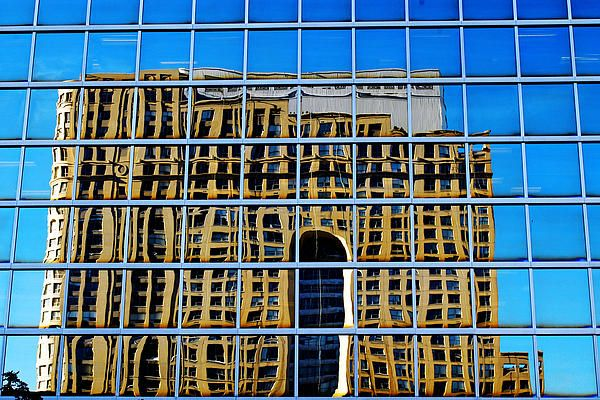 Standing at the south west corner of Scott & Front streets in downtown Toronto, I looked north at the building at 33 Yonge Street to see the reflection of the part Novotel Hotel, part condo behind me. I love how the imperfections in the glass render the reflection so imperfectly. #reflection, #distortion, #imperfection