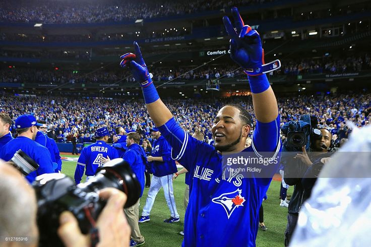 Edwin Encarnacion #10 of the Toronto Blue Jays celebrates after hitting a three-run walk-off home run in the eleventh inning to defeat the Baltimore Orioles 5-2 in the American League Wild Card game at Rogers Centre on October 4, 2016 in Toronto, Canada.