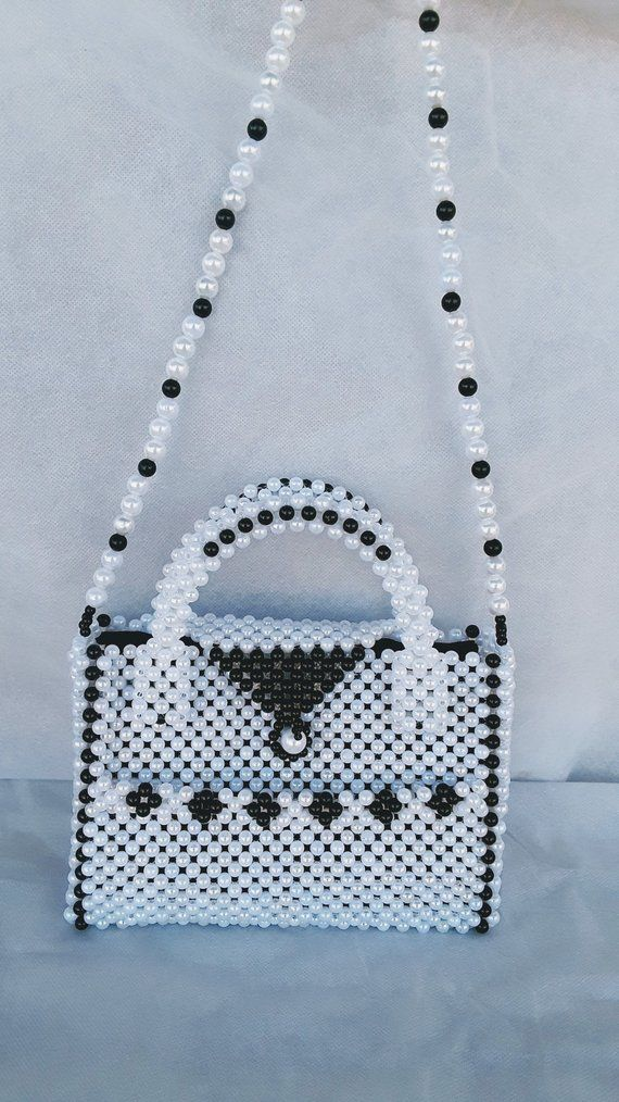 3d8f8f537c228 A handmade women handbag made with pearl beads pearl clutch
