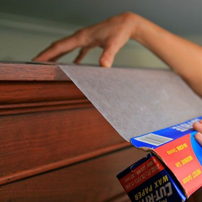 Place a layer of wax paper on top of upper kitchen cabinets where dust and grease particles gather. Every few months, switch out the paper for a fresh sheet. Includes other wax paper uses.  Why didn't I think of this?