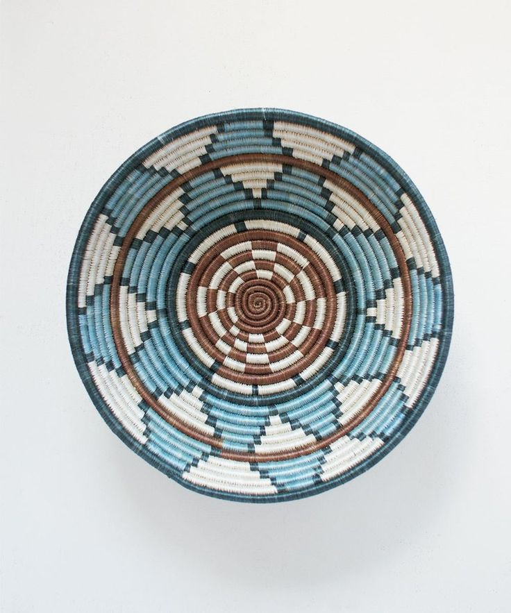 Intricately woven by Craftswomen in Rwanda using timeless tradition to weave carefully dyed sisal fibers and sweet grass into stunning one-of-a-kind pieces! The perfect size for a center piece, fruit