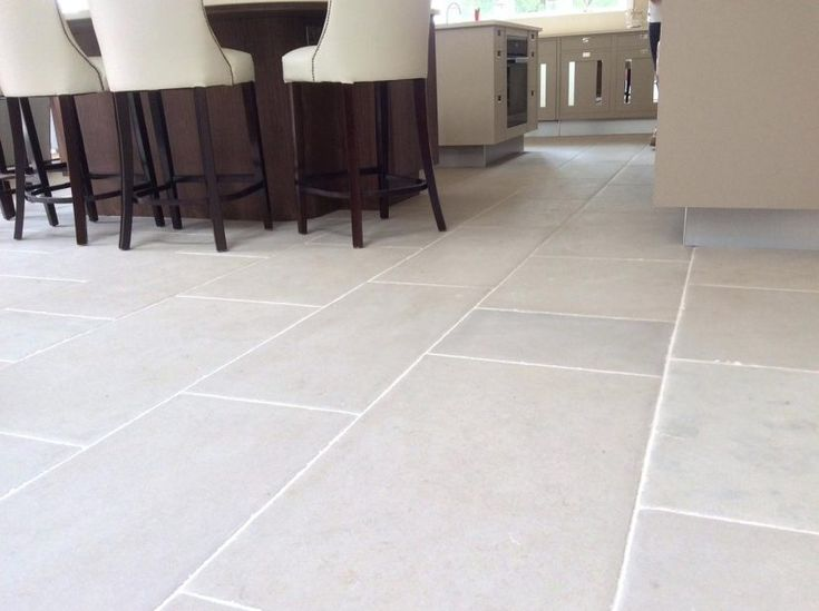 luberon stone flooring hand distressed antiqued limestone beige brown in tone with a light hintgrey effect