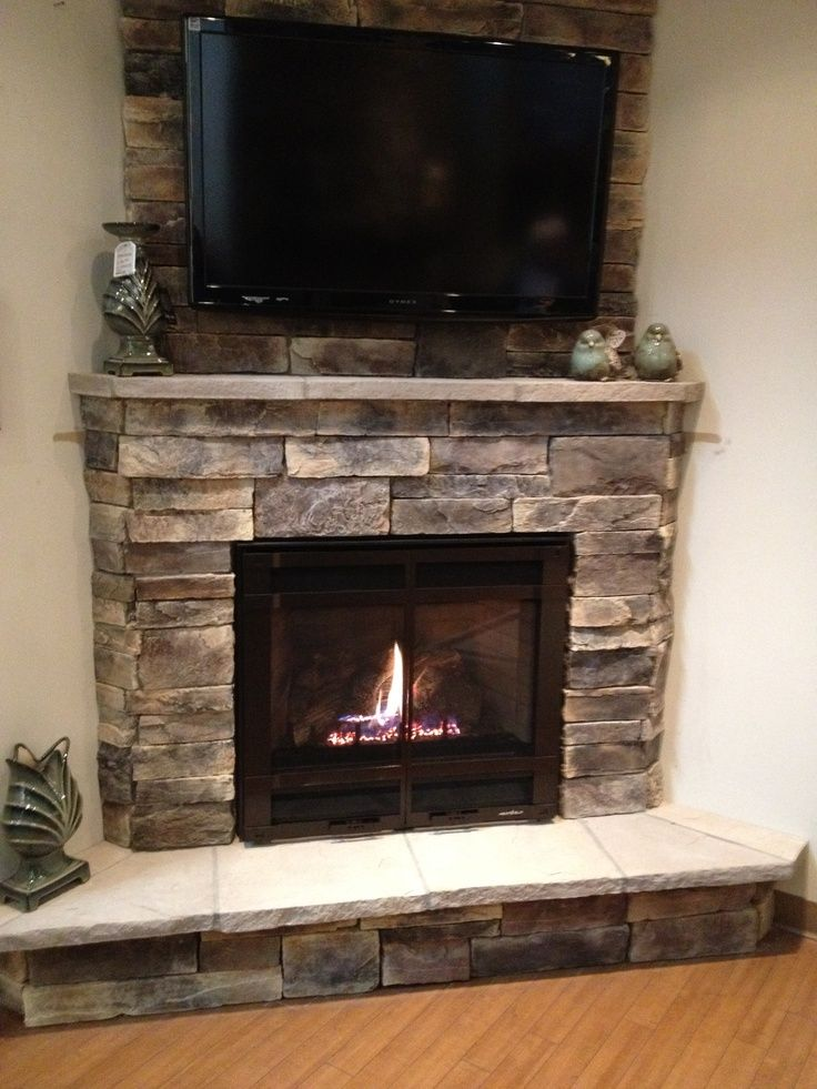 Corner fireplace with TV hung above with furniture layout ...