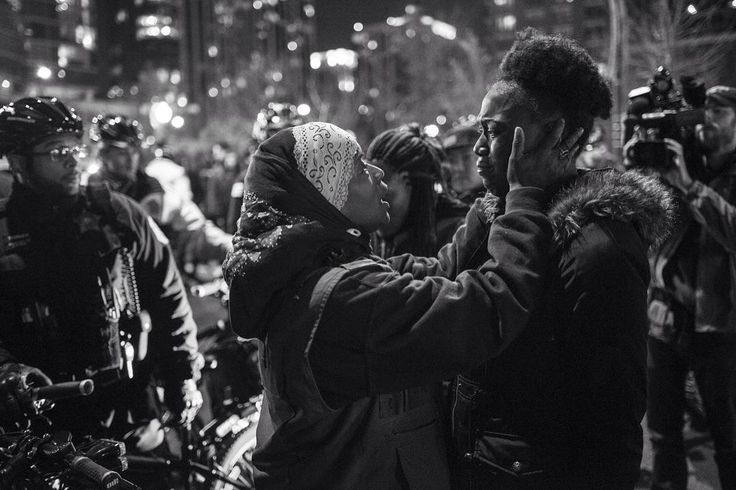 #NOORTakeover on racism in USA:  @JonLowenstein / #noorimages. Community organizer and violence interrupter Ameena Matthews comforts protestor Kirah Moe during a particularly emotional moment while protesting against #policebrutality in #Chicago. #USA 2015  Upwards of 500 hundred people marched throughout downtown Chicago on Tuesday November 24 to protest the police killing of #LaquanMcDonald at the hands of Chicago police officer Jason Van Dyke.  McDonald was shot sixteen times and the…