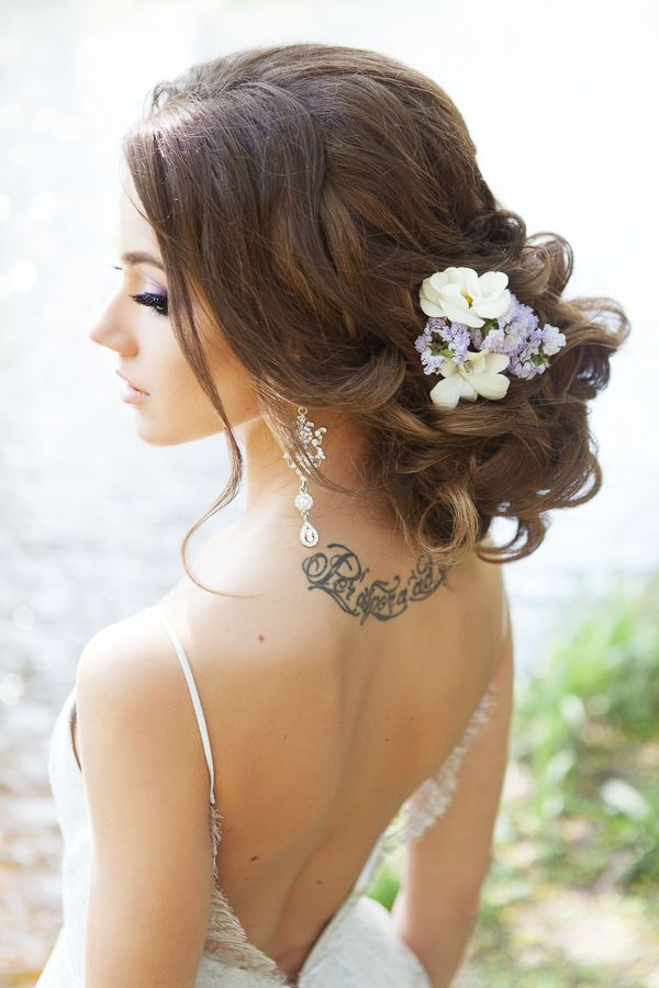 long bridal updo hairstyle with wildflower
