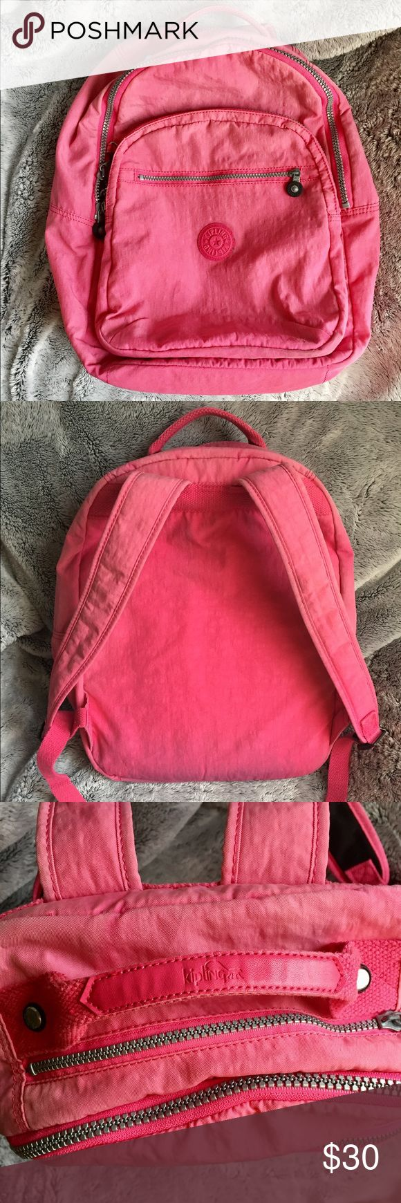 Kipling Seoul Laptop Backpack Super cute Kipling Seoul laptop backpack in a light, bright pink. This bag has been well loved but has a ton of life left. The color has faded a little and the medium pocket in the middle has dirt/pen stains on the bottom that you can see on the outside. There are dirt marks along the bottom of the outside of the bag. Hardware is chipped/faded but zippers work flawlessly. No stains in main compartment and no rips/tears. Make me an offer! <3 Kipling Bags…