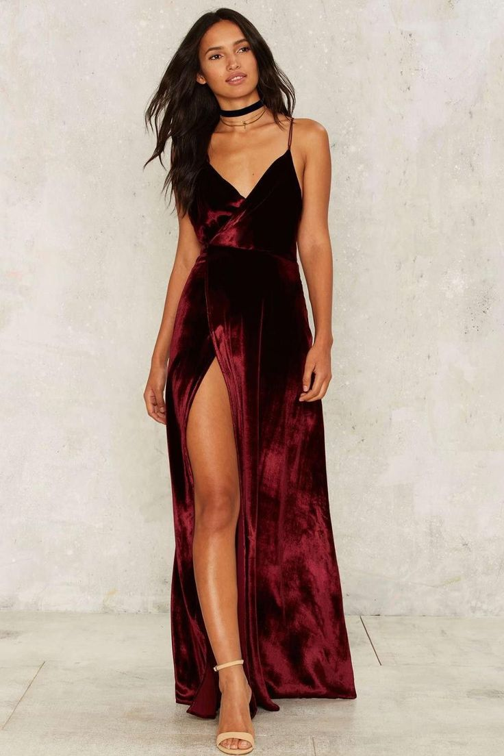 Gender: Women Silhouette: Fit and Flare Material: Velvet Spandex, Polyester Sleeve Length: Sleeveless Neckline: V-Neck Waistline: Empire, High Leg Slit Pattern Type: Solid Sleeve Style: Spaghetti Stra