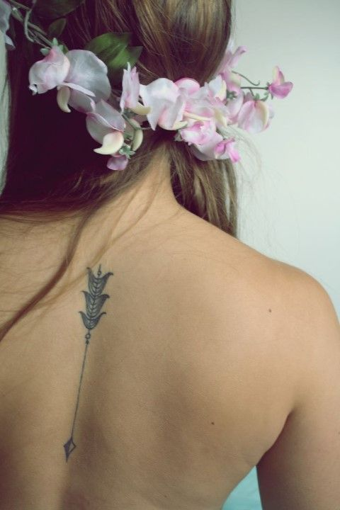 nature arrow back tattoo for girls